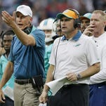 Joe Philbin, left, seen during Miami's game against the Jets on Sunday in London, was fired Monday as head coach of the Dolphins.