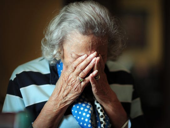 West Tennessee resident Hattye Yarbrough bows her head