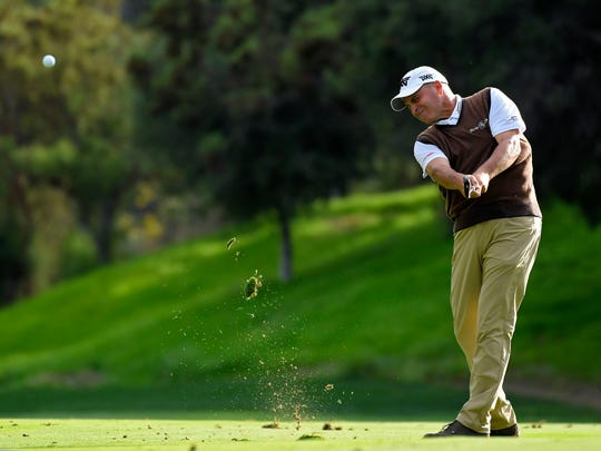 Rocco Mediate hits a fairway shot on the 18th hole during the second round of the PowerShares QQQ Championship Golf Tournament Saturday at Sherwood Country Club in Thousand Oaks. The revamped course was popular with the players.