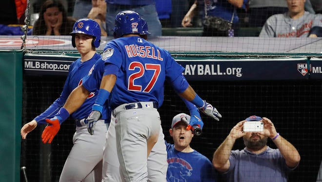 epa05613409 Chicago Cubs batter Addison Russell celebrates with teammates after hitting a grand slam home run in the top of the third inning of game six of the World Series between the Chicago Cubs and the Cleveland Indians at Progressive Field in Cleveland, Ohio, USA, 01 November 2016. The Indians lead the best-of-seven series 3-2 and can win the series with a game six win, otherwise game seven on 02 November will determine the winner.  EPA/DAVID MAXWELL