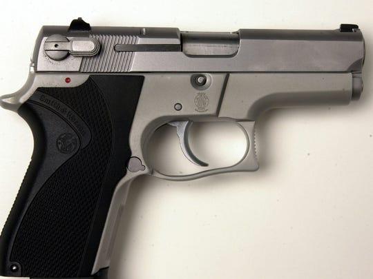A Smith & Wesson 9mm handgun.