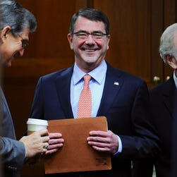 Defense Secretary Ashton Carter, R, and Chairman of the Joint Chiefs of Staff Gen. Martin Dempsey enter a hearing room to testify before the House Armed Services Committe in Washington, D.C. on March 18, 2015.