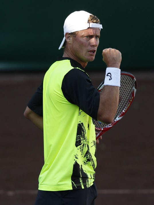 Lleyton Hewitt, of Australia, pumps his fist after scoring a point against Canada's Peter Polansky at the U.S. Men's Clay Court Championship tennis tournament, Tuesday, April 8, 2014, in Houston. Hewitt won 6-4, 3-6, 6-4. (AP Photo/Houston Chronicle, Thomas B. Shea) MANDATORY CREDIT