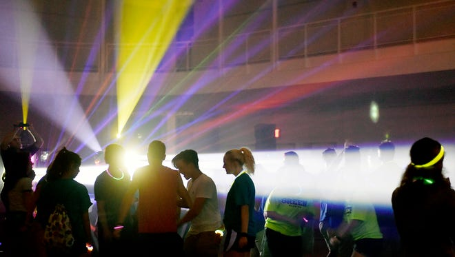 York College students attend a dance party in the Grumbacher Sport and Fitness Center field house during a Club Spartan orientation event. York College welcomed about 900 new students Friday and hosted Club Spartan to introduce freshmen to the recreation complex.
