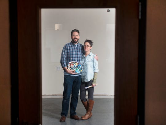 Jim and Erin McHugh stand in the building located on Broad Street in Woodbury where they are opening up an arts center. 02.05.15