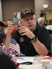 Vietnam veteran Larry Willenborg shares some stories at his table at the Nov. 3 veterans' gathering at the Novi Civic Center.