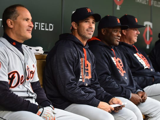 Tigers manager Brad Ausmus, second from left, sits