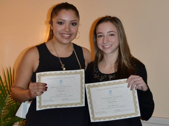 Alyssa Lopez (left) and Taylor Groves of Millville