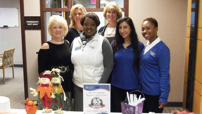 Linda Hatfield (back, from left) and Alisa Williams, along with Renee Doyle (front, from left), Zandra Tillman, Chloe Denha and Dana Smith helped the credit union mark its 85th anniversary.