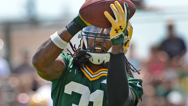 Green Bay Packers cornerback Davon House grabs a pass during minicamp practice at Ray Nitschke Field, Tuesday, June 17, 2014. H. Marc Larson/Press-Gazette Media