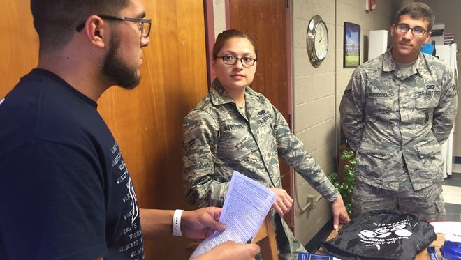 Deming High senior Joshua Morales discusses his enlistment papers with is United States Air Force recruiters. Morales will graduate from DHS in June and report for basic training with the USAF in July.