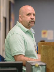 Student worker Jeremy Wells, 46, works at the computer