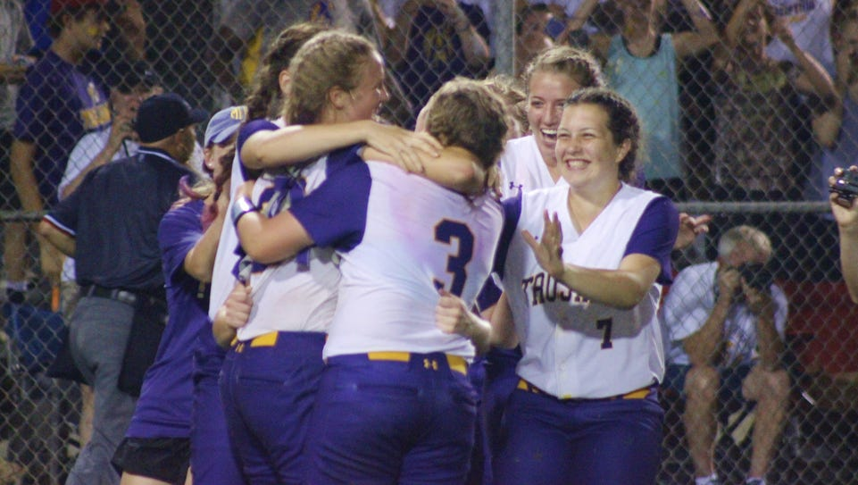 The ASH Lady Trojans celebrate winning the Class 5A