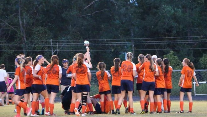 The Dickson County High School Lady Cougars soccer team celebrates its 1-0 victory over Creek Wood on Tuesday night.