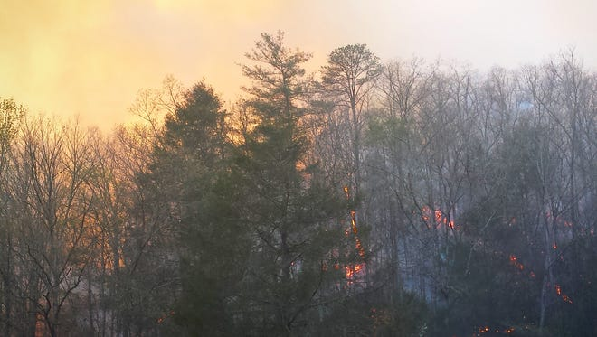 The Silver Mine Fire burns near Hot Springs in Madison County. Smoke settled over Asheville Tuesday evening.