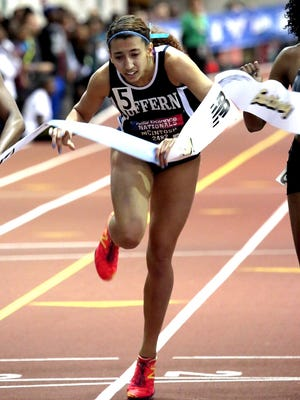 Kamryn McIntosh of Suffern leans across the tape to win the girls 400 meters Sunday at the New Balance Indoor Nationals.