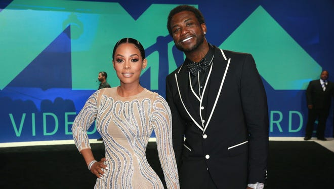 Keyshia Ka'Oir (L) and Gucci Mane attend the 2017 MTV Video Music Awards at The Forum on August 27, 2017 in Inglewood, California.