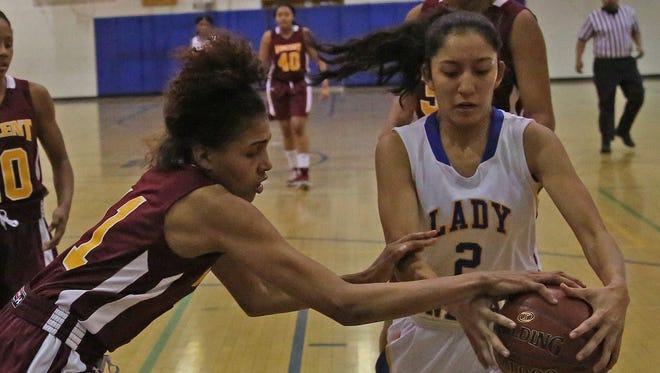 Vincent's Ariel Kirkwood tries to steal the ball from King's Annaly Garcia.