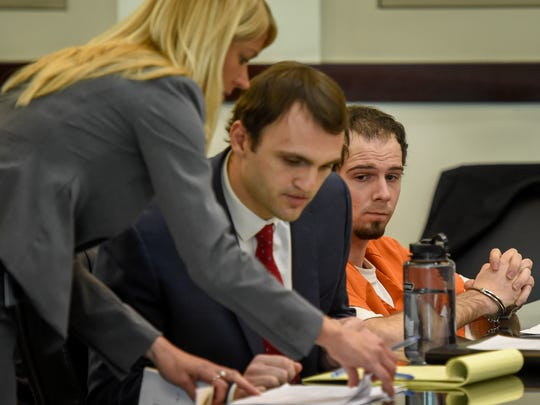 Assistant District Attorney General Jan Norman talks with defense attorney Nicholas McGregor as Chris D. McLawhorn watches on Thursday March 16, 2017 at the Justice A. Birch Building in Nashville, Tenn. McLawhorn is charged in the stabbing death of Nashville nurse Tiffany Ferguson.