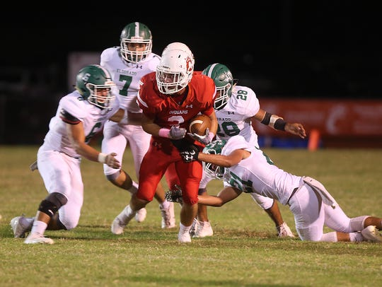 Christoval's Trace Edmiston is tackled by Eldorado defenders during Friday night's game in Christoval, Oct. 13, 2017.