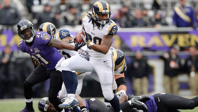 St. Louis Rams running back Todd Gurley (30) carries the ball during the second quarter against the Baltimore Ravens at M&T Bank Stadium.