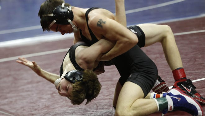 Clarion-Goldfield-Dows' Josh Portillo takes down New Hampton's Mason Cleveland to the mat in the state dual tournament.