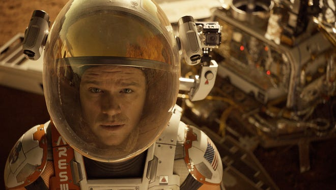 """In this photo provided by Twentieth Century Fox, Matt Damon as Astronaut Mark Watney finds himself stranded and alone on Mars, in """"The Martian."""""""