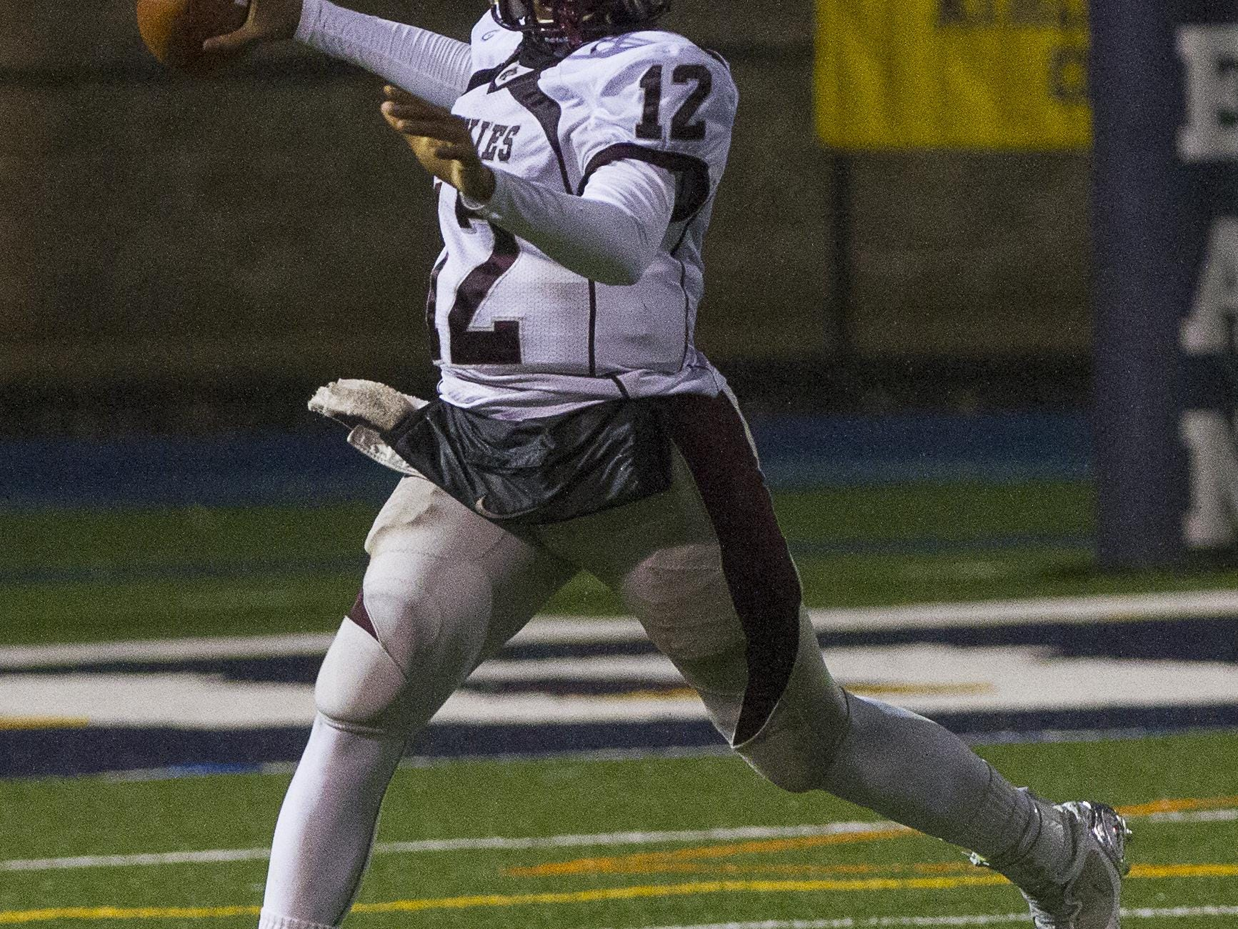Matawan's George Pearson throws against Carteret in the Central Group III football championship at Kean University on Dec. 5, 2014.