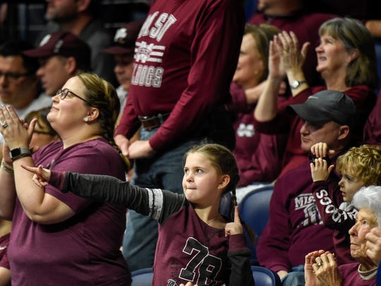 Mississippi State Lady Bulldogs fans of all ages cheer