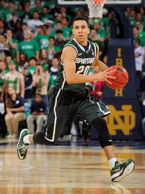 Michigan State guard Travis Trice heads up court during the first half of an NCAA college basketball game with Notre Dame Wednesday Dec. 3, 2014, in South Bend, Ind.