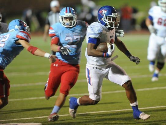 Cooper running back Tyrees Whitfield, right, runs for