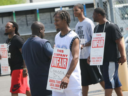 Torin Collins and other workers picket outside of Canada Dry Distributing Co. of Wilmington's New Castle warehouse Friday.