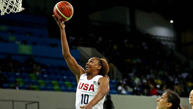 Aug 10, 2016; Rio de Janeiro, Brazil; USA forward Tamika Catchings (10) shoots the ball against Serbia power forward Jelena Milovanovic (9) during the women's basketball preliminary round in the Rio 2016 Summer Olympic Games at Youth Arena.