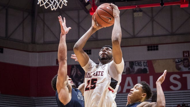 Ball State's Tahjai Teague attempts the layup during the game against Akron on Jan. 27 at Worthen Arena.