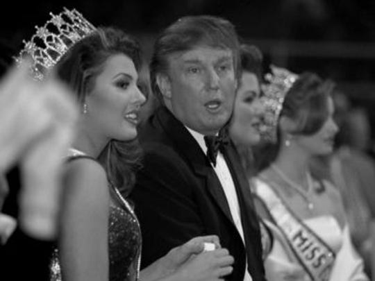 Donald Trump talks with Miss USA 1996 Ali Landry during the 1997 Miss USA pageant in Shreveport.