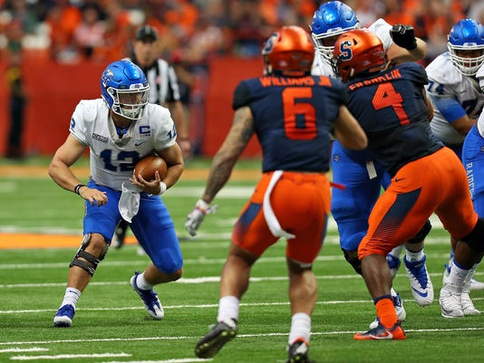 MTSU quarterback Brent Stockstill runs vs. Syracuse