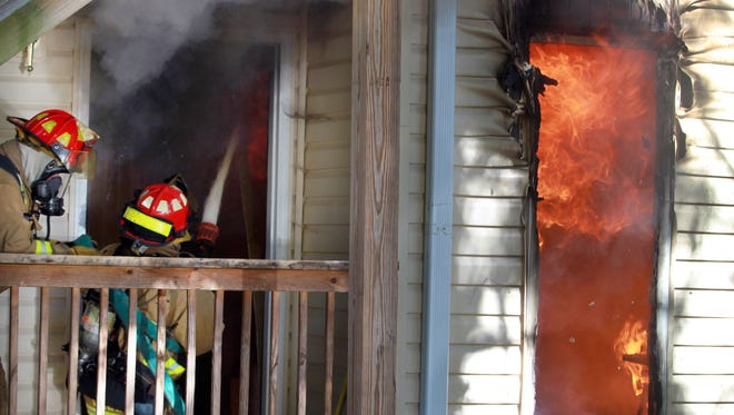 Firefighters battle a blaze in Fort Mitchell Tuesday morning.