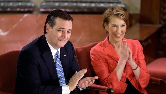 Republican presidential candidate, Sen. Ted Cruz, R-Texas, and vice-presidential candidate Carly Fiorina applaud during a question and answer session with Fox News Channel's Sean Hannity at The Indiana War Memorial Friday.