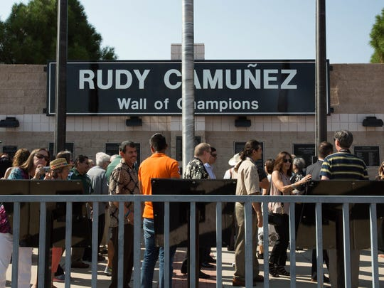 Relatives and friends of the Bradley and Camuñez families gathered during the dedication of the Rudy Camuñez Wall of Fame and the Induction of Coaches Jim Bradley and Rudy Camuñez into the Walk of Fame, Thursday Aug. 31, 2017.