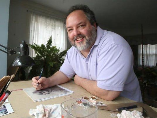 Artist Russell Paul Fernando at work