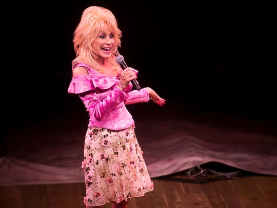 Dolly Parton speaks prior to the start of her new dinner