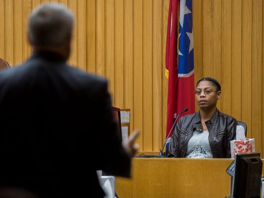 Natasha Colbert, who lived at the apartment where Zaevion Dobson was shot, is questioned by prosecutor Phil Morton, left, during the Zaevion Dobson slaying trial at Knox County Criminal Court on Wednesday, Dec. 6, 2017.