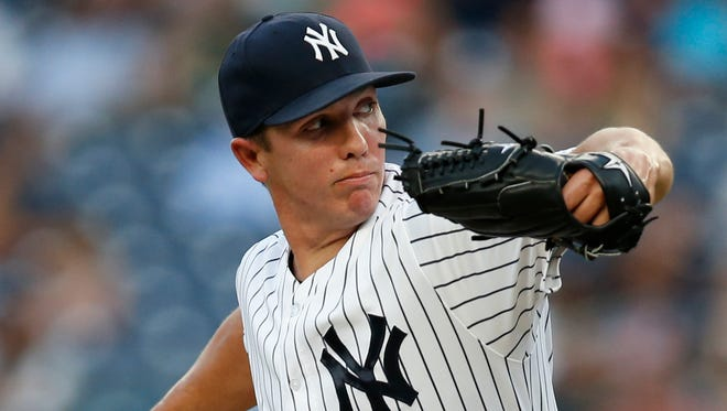 New York Yankees starting pitcher Chad Green winds up during the first inning of a baseball game against the Toronto Blue Jays in New York, Monday, Aug. 15, 2016.