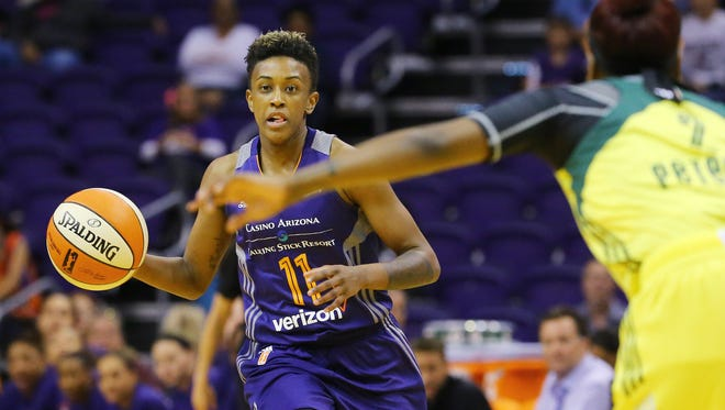 Phoenix Mercury guard Danielle Robinson (11) against the Seattle Storm during the second half of their WNBA game Sunday,  May 7, 2017 in Phoenix, Ariz.