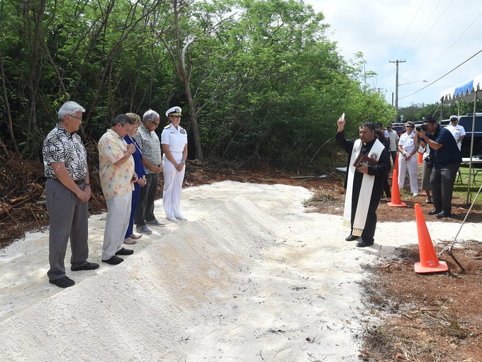 Rev. Mike Crisostomo blesses the Guam Cultural Repository