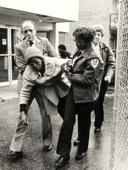 March 31, 2018 - This March 1988 photo shows sheriff's deputies carrying Jacqueline Smith out of the Lorraine Motel. Jacqueline Smith has been encamped in protest on the sidewalk across from the Lorraine Motel since she was evicted in March 1988.