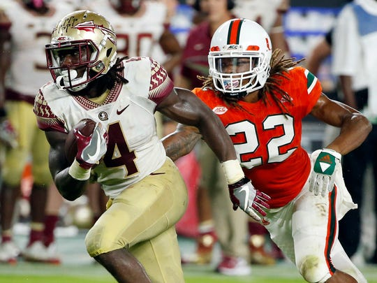 FILE - In this Oct. 8, 2016, file photo, Florida State running back Dalvin Cook (4) carries the ball ahead of Miami defensive back Sheldrick Redwine (22) during the second half of an NCAA college football game in Miami Gardens, Fla. The Seminoles host Wake Forest on Saturday. (AP Photo/Wilfredo Lee, File)