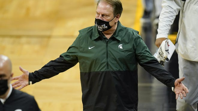 Michigan State head coach Tom Izzo walks off the court at halftime of an NCAA college basketball game against Iowa, Tuesday, Feb. 2, 2021, in Iowa City, Iowa.
