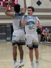 Rattler Wes Lynch, number 30, goes through pregame drills with Marques Prior on Friday, January 19, 2018 in Rancho Mirage.
