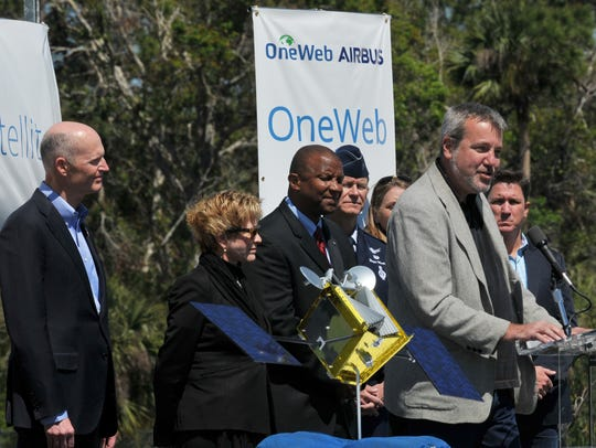 Florida Gov. Rick Scott, at left, attended the 2017 groundbreaking ceremony for OneWeb Satellites' Spacecraft Integration Facility at Kennedy Space Center's Exploration Park. Speaking at the podium was OneWeb Satellites CEO Brian Holz.